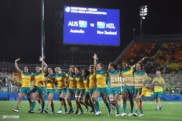 Australia celebrate victory after winning the Women's Gold Medal Final Rugby Sevens match between Australia and New Zealand on August 8, 2016 in Rio...