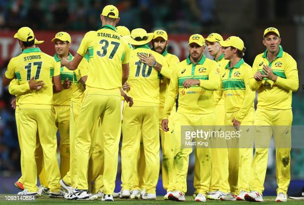 Australia celebrate victory during game one of the One Day International series between Australia and India at Sydney Cricket Ground on January 12...