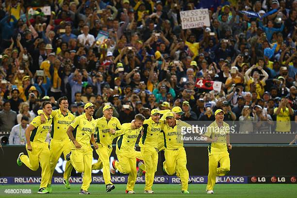 Australia celebrate victory during the 2015 ICC Cricket World Cup final match between Australia and New Zealand at Melbourne Cricket Ground on March...