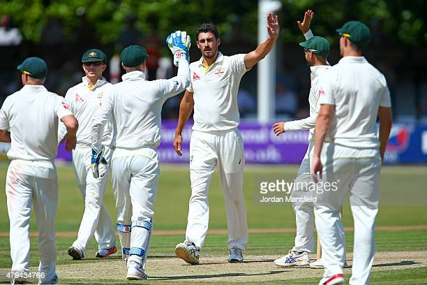 Australia celebrate with Mitchell Starc after he bowls out James Foster of Essex during day four of the tour match between Essex and Australia at The...