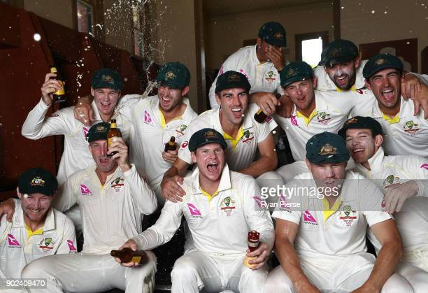 Australia celebrate with the Ashes Urn in the changreooms during day five of the Fifth Test match in the 2017/18 Ashes Series between Australia and...
