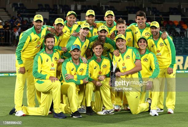 Australia celebrate with the Series Trophy after game three of the One Day International series between Australia and India at Manuka Oval on...