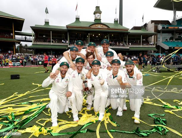 Australia celebrate with the TransTasman Trophy during day four of the Third Test Match in the series between Australia and New Zealand at Sydney...