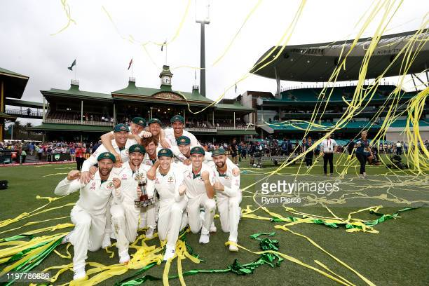 Australia celebrate with the Trans-Tasman Trophy during day four of the Third Test Match in the series between Australia and New Zealand at Sydney...