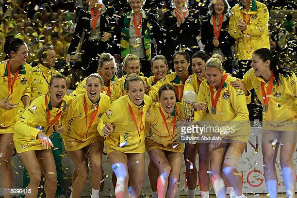 Australia, celebrate with the trophy after defeating New Zealand in the final of the 2011 World Netball Championships at Singapore Indoor Stadium on...
