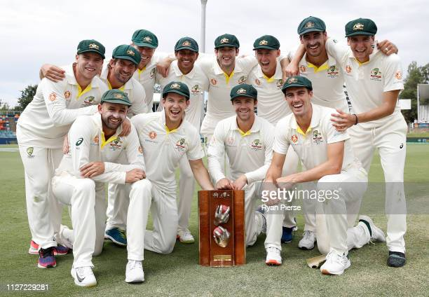 Australia celebrate with the trophy during day four of the Second Test match between Australia and Sri Lanka at Manuka Oval on February 04 2019 in...