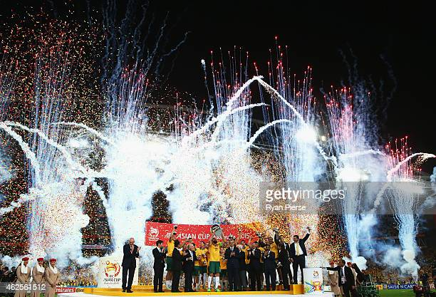 Australia celebrate with the trophy during the 2015 Asian Cup final match between Korea Republic and the Australian Socceroos at ANZ Stadium on...