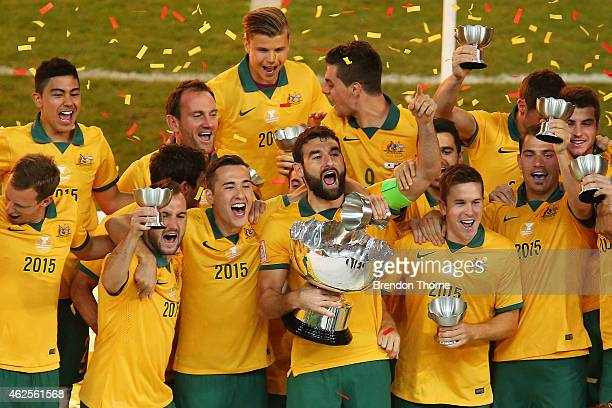 Australia celebrate with the trophy following the 2015 Asian Cup final match between Korea Republic and the Australian Socceroos at ANZ Stadium on...