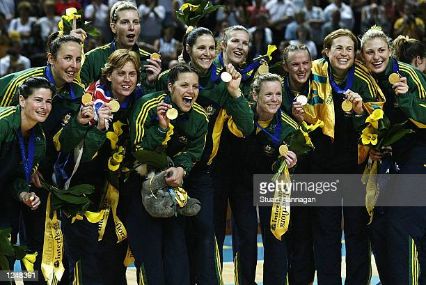 Australia celebrate with their medals after winning gold in the New Zealand v Australia Women's Netball final at the MEN Arena during the 2002...