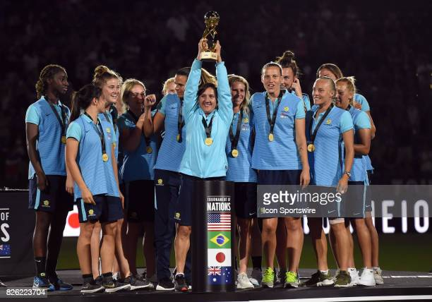 Australia celebrates after receiving the trophy as winners of the Tournament of Nations during the Tournament of Nations soccer match between USA and...