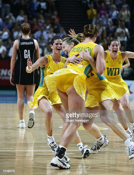 Australia celebrates after winning gold in the New Zealand v Australia Women's Netball final at the MEN Arena during the 2002 Commonwealth Games in...