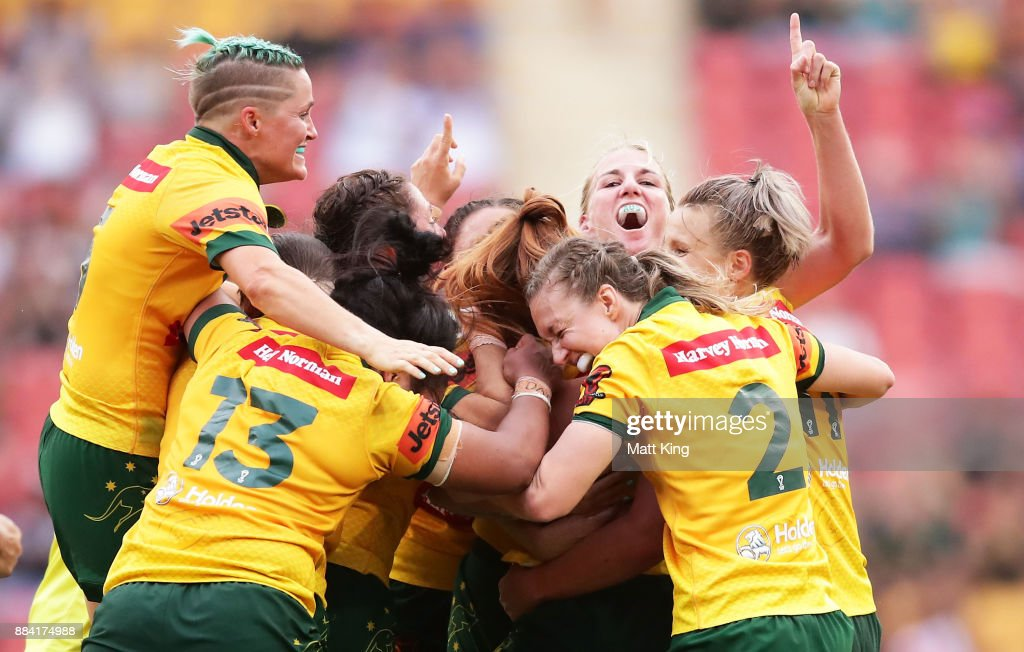 Australia celebrates victory at the end of the 2017 Rugby League Women's World Cup Final between Australia and New Zealand at Suncorp Stadium on December 2, 2017 in Brisbane, Australia.
