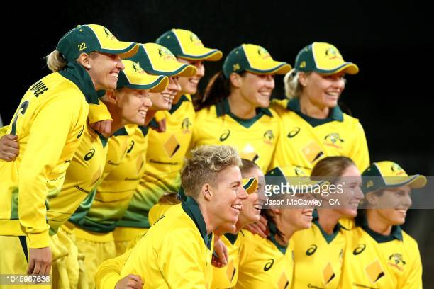 Australia celebrates winning game three and the Twenty20 series between Australia and New Zealand at Manuka Oval on October 5 2018 in Canberra...