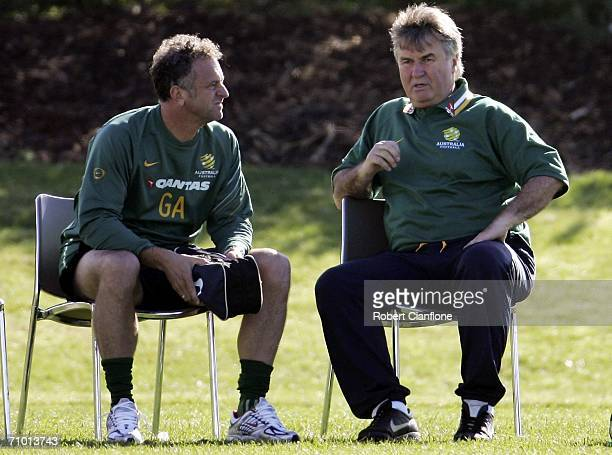 Australia coach Guus Hiddink talks with assistant coach Graham Arnold during a training session held at the Melbourne Grammar Sports Ground May...