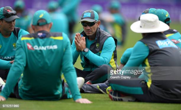 Australia coach Justin Langer speaks to his team during a nets session at SWALEC Stadium on June 15 2018 in Cardiff Wales