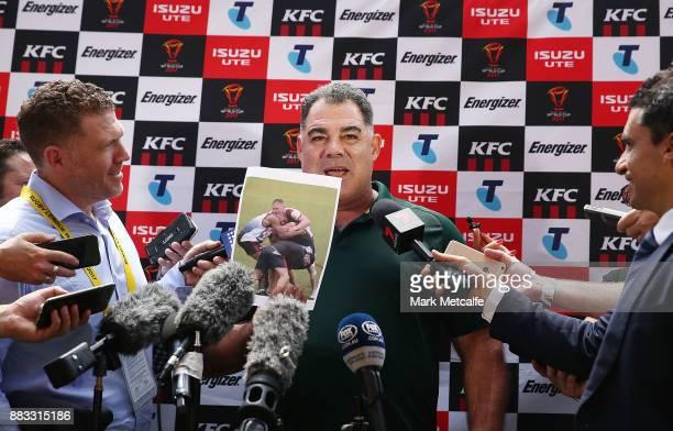 Australia coach Mal Meninga shows photos to media before an Australian Kangaroos training session at Suncorp Stadium on December 1 2017 in Brisbane...