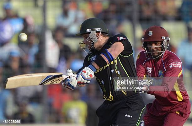 Australia cricketer Brad Hodge plays a shot as West Indies wicketkeeper Denesh Ramdin looks on during the ICC World Twenty20 tournament Group 2...