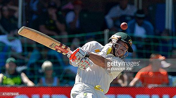 Australia cricketer David Warner tries to avoid a bouncer during Australia's second innings in the second test match between South Africa and...