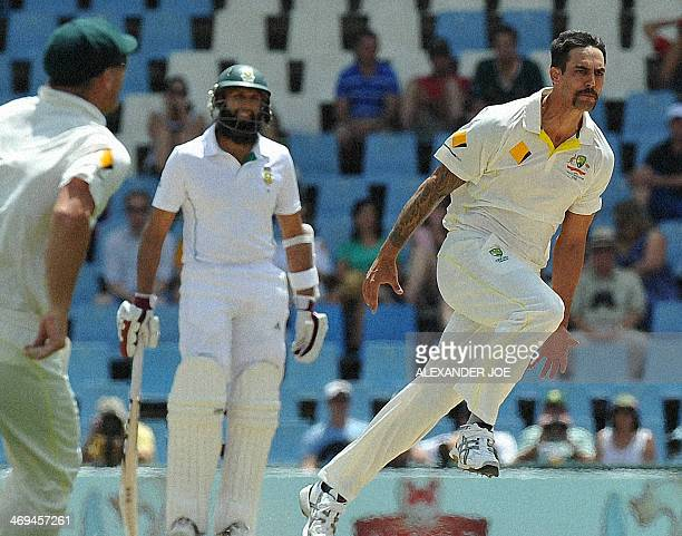 Australia cricketer Mitchell Johnson celebrates his second wicket of the day South Africa's Graeme Smith out for 4 runs during the 4th day of the...