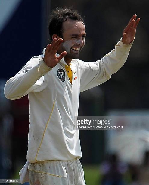Australia cricketer Nathan Lyon celebrates after he dismissed unseen Sri Lankan batsman Rangara Herath during the second day of the opening Test...