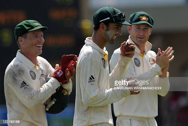 Australia cricketer Nathan Lyon leaves the grounds at the end of the Sri Lankan innings as captain Michael Clarke and wicketkeeper Brad Haddin...