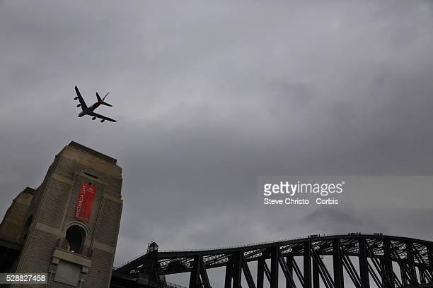 Australia Day celebrations on Sydney Harbour foreshore A Qantas A380 flies over the Sydney Harbour Bridge at an unusually low level Sydney Australia...