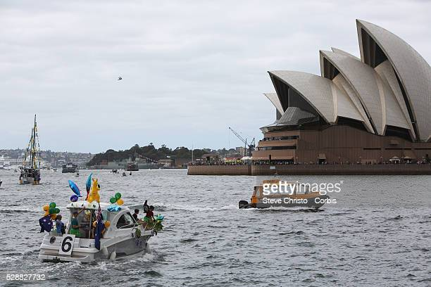 Australia Day celebrations on Sydney Harbour foreshore Procession of boats pass under the Sydney Harbour Bridge Sydney Australia Sunday 26th January...