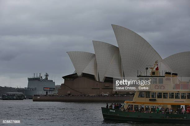 Australia Day celebrations on Sydney Harbour foreshore Sydney Australia The HMAS Choules sits in front of the Sydney Opera House with The...