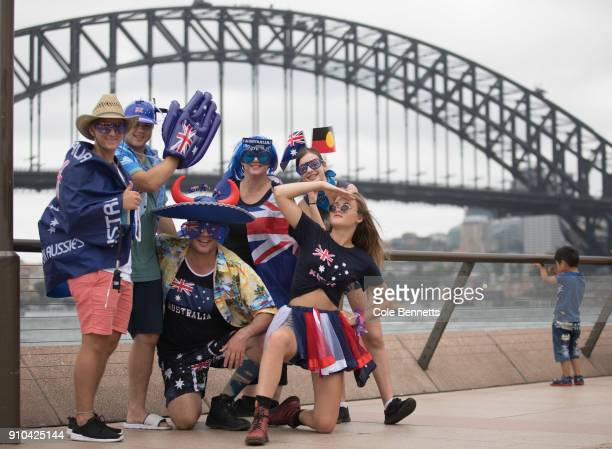 Australia Day revelers pose for photos at Circular Quay on January 26, 2018 in Sydney, Australia. Australia Day, formerly known as Foundation Day, is...