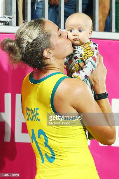 Australia defender Edwina Bone kisses a baby during Hockey on day five of the Gold Coast 2018 Commonwealth Games at Gold Coast Hockey Centre on April...