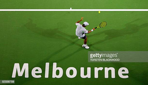 Dominik Hrbaty of the Slovak Republic casts a shadow during his men's singles quarterfinal match against fourth seed Marat Safin of Russia at the...