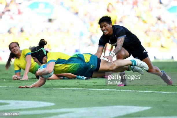 Australia Emilee Cherry scores a try in the Women's Gold Medal Rugby Sevens Match between Australia and New Zealand on day 11 of the Gold Coast 2018...