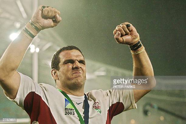 English captain and lock Martin Johnson celebrates after winning Rugby World Cup final at the Olympic Park Stadium in Sydney, 22 November 2003....