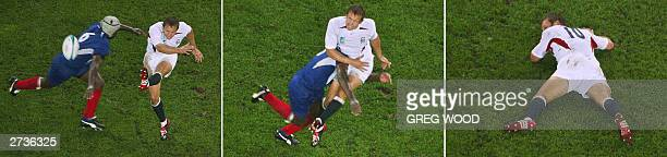 English flyhalf Jonny Wilkinson is tackled by French flanker Serge Betsen during the Rugby World Cup 2003 semifinal match between France and England...