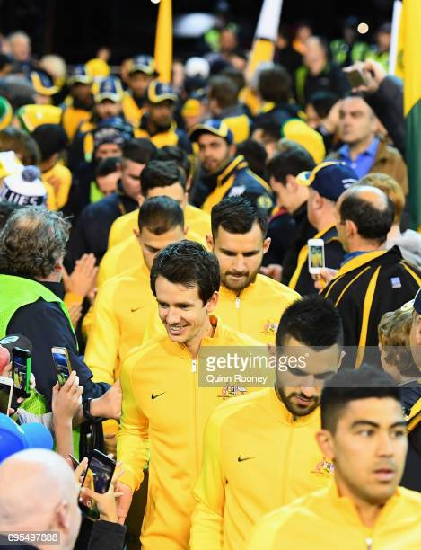 Australia enters the arena through the crowd during the Brazil Global Tour match between Australian Socceroos and Brazil at Melbourne Cricket Ground...