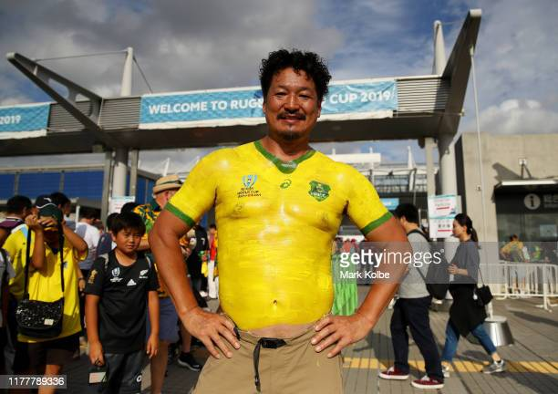 Australia fan poses for a photo outside the stadium prior to the Rugby World Cup 2019 Group D game between Australia and Wales at Tokyo Stadium on...
