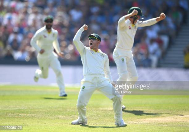 Australia fielder David Warner celebrates after catching out England batsman Joe Root during day four of the 3rd Ashes Test Match between England and...