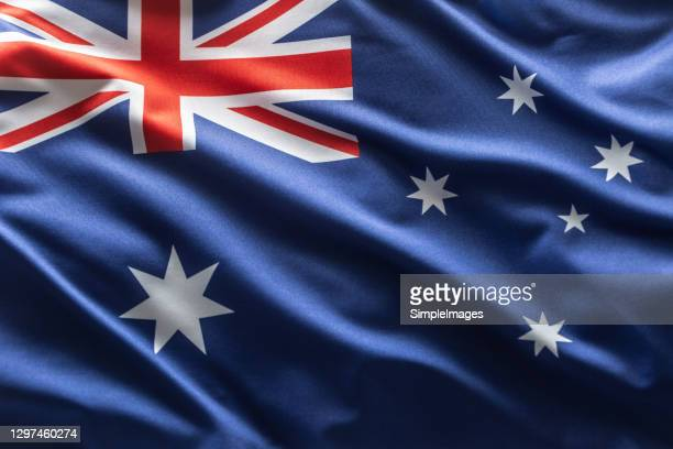australia flag blowing in the wind. - australian flag stock pictures, royalty-free photos & images