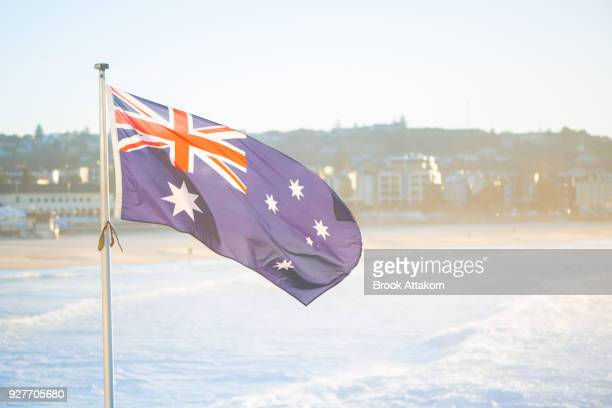 australia flag on the beach. - australian flag stock pictures, royalty-free photos & images