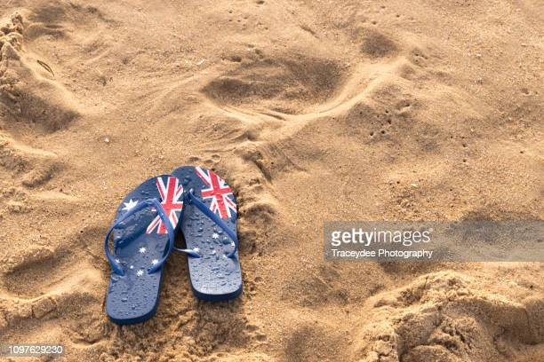 australia flag thongs or flip-flops on an australian beach - australian flag stock pictures, royalty-free photos & images