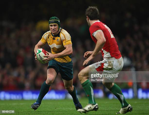 Australia fly half Matt Giteau makes a break during the Invesco Perpetual match between Wales and Australia at Millennium Stadium on November 28 2009...