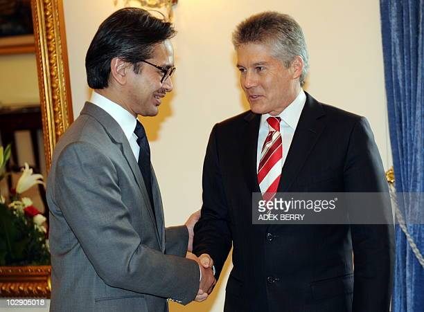 Australia Foreign Minister Stephen Smith shakes hand with to his Indonesian counterpart Marty Natalegawa prior to a bilateral meeting in Jakarta on...