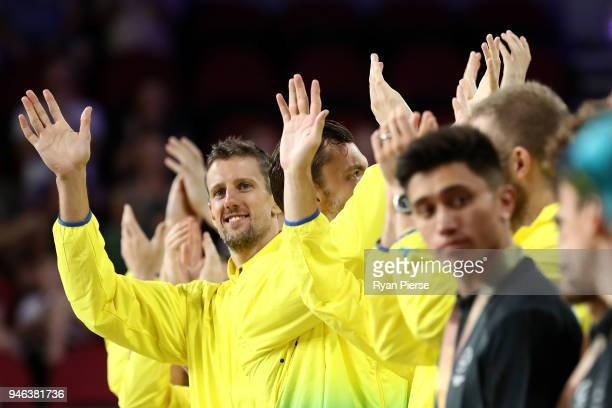 Australia forward Daniel Kickert waves during the medal ceremony for the Men's Gold Medal Basketball Game between Australia and Canada on day 11 of...