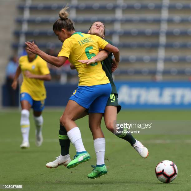 Australia forward Hayley Raso and Brazil forward Tamires collide going for the ball in the first half of a women's soccer match between Brazil and...