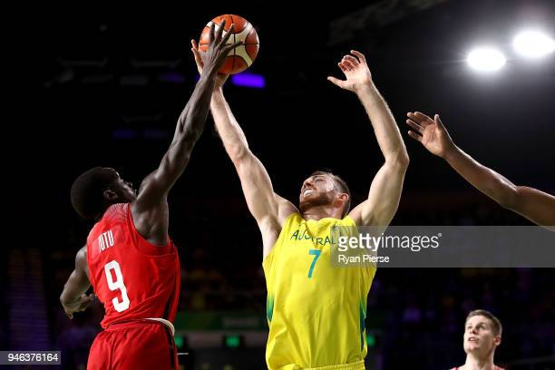 Australia forward Nicholas Kay and Canada guard Munis Tutu compete during the Men's Gold Medal Basketball Game between Australia and Canada on day 11...