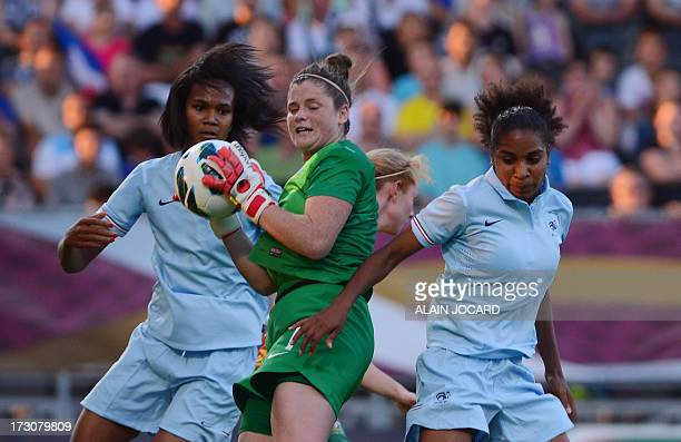 Australia goalkeeper Brianna Davey catches the ball in front of France defender Wendy Renard on July 6 2013 during a friendly women's football match...