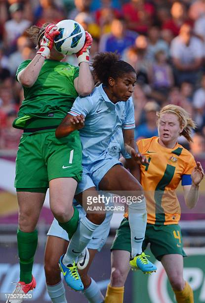 Australia goalkeeper Brianna Davey catches the ball in front of France forward Elodie Thomis on July 6 2013 during a friendly women's football match...