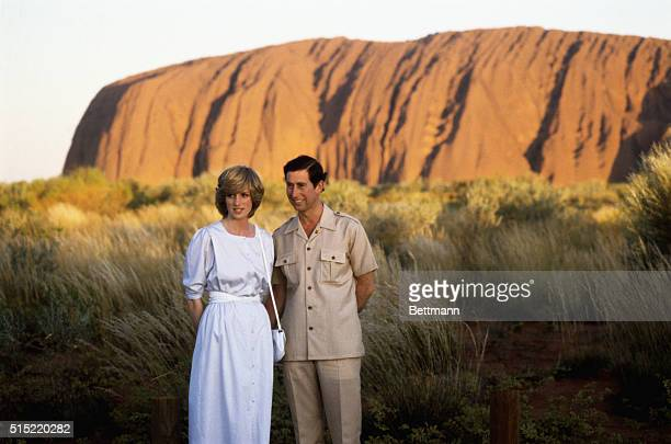 Great Britain's Prince Charles and Princess Diana pose before the Australian Monolithic Rock during their tour of Australia