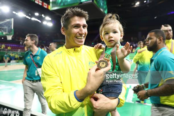Australia guard Damian Martin celebrates winning gold during the medal ceremony for the Men's Gold Medal Basketball Game between Australia and Canada...