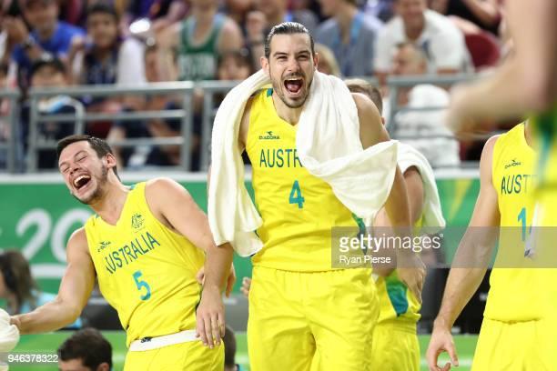 Australia guard Jason Cadee and Australia guard/forward Chris Goulding celebrate during the Men's Gold Medal Basketball Game between Australia and...